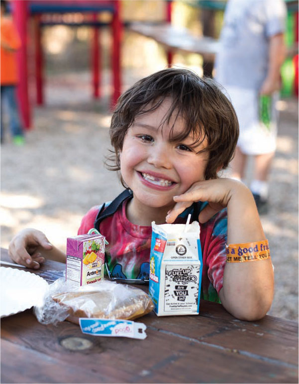 foodbankst happy child enjoying lunch - Donate - February