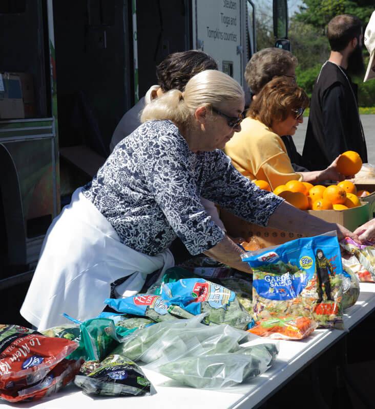 foodbankst volunteers handing out fruits - SNAP